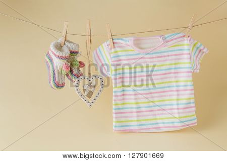 baby goods hanging on the clothesline with heart