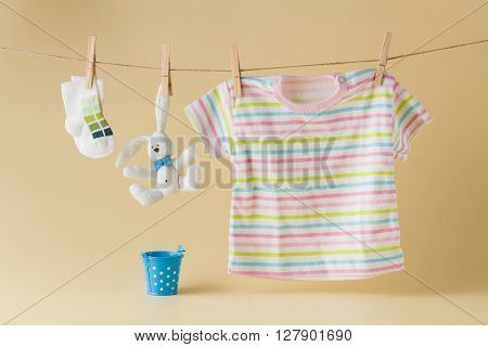Baby Socks And Clothes Hanging On The Clothesline