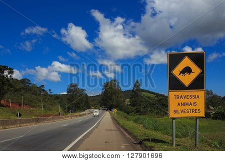 wild animals crossing sign on a brazilian road at sunny day