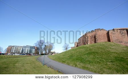 CHESTER, UK - MARCH 10, 2015: A wide angle view of both the luxury Abode hotel and Chester castle, Chester, Cheshire, UK