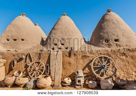 HARRAN TURKEY - SEPTEMBER 27 2012: Traditional mud brick buildings topped with domed roofs and constructed from mud and salvaged brick.