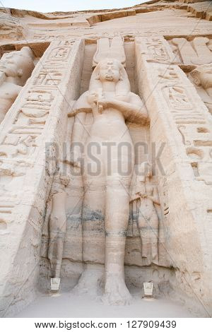giant Nefertari sculpture in facade of famous Egyptian small temple of Nefertari and Hathor in Abu Simbel public monument from 13th century Before Christ in Nubia Egypt Africa