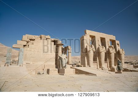 landmark Egyptian Temple Ramesseum monument memorial temple of pharaoh Ramesses II with big sculptures and statues in ancient Thebes in Luxor Egypt Africa