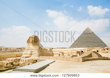landmark of famous Great Sphinx from century XXVI Before Christ and behind the Great Pyramid of Khafre in Giza next to Cairo city Egypt Africa