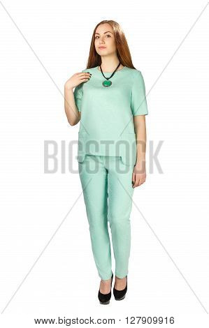 Full body brunette woman in blue pantsuit standing in studio isolated on white