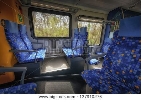 Modern european economy class fast train interior angle shot