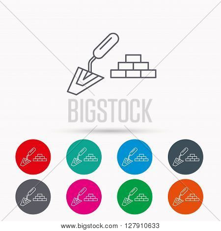 Finishing icon. Spatula with bricks sign. Linear icons in circles on white background.