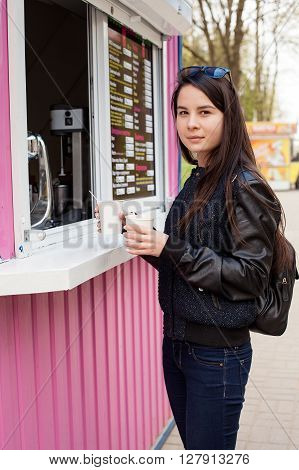Lunch Time. Young Woman Buying Coffee