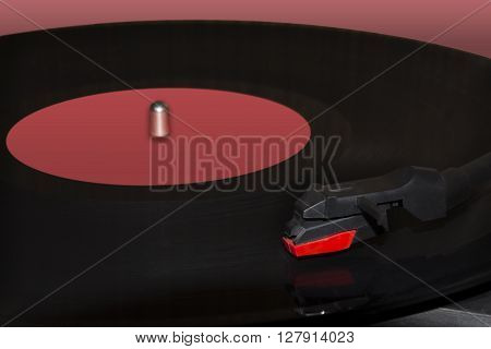 Playing of a track on a vinyl phonograph record