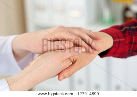 Woman Doctor Hands Holding Female Child Patient Hand