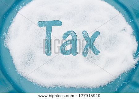 Close-up of Teal Plate with a lot of sugar with text Tax