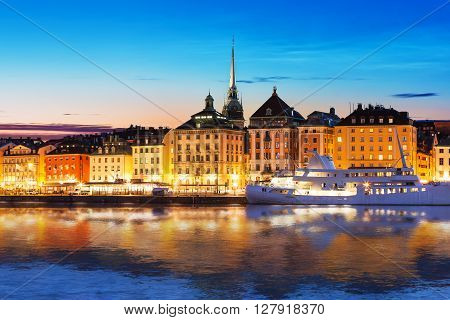 Scenic summer evening panorama of the Old Town (Gamla Stan) architecture pier in Stockholm Sweden