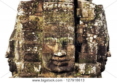 Giant stone faces at ancient Bayon temple isolated on white background, Angkor, Siem Reap, Cambodia.
