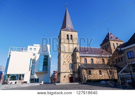 Heerlen Netherlands - April 11 2016: town heart of Heerlen with Pancratius Church. Heerlen is a town in the Dutch province Limburg with about 90.000 inhabitants near the border to Germany