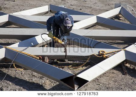 Cutting and sanding metal structures at a construction field