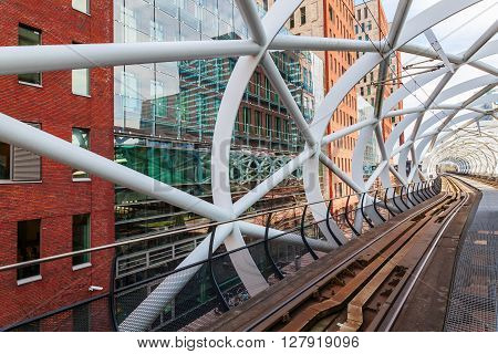 The Hague Netherlands - April 21 2016: Netkous viaduct at Beatrixkwartier with RandstadRail station. It is a modern construction designed by Zwarts & Jansma architects