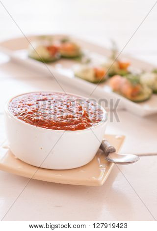 Chili dipping sauce with snacks in the background