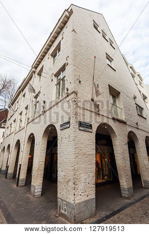 Maastricht Netherlands - April 11 2016: historical house with shopping arcades in Maastricht. Maastricht is a university city and the capital of the Dutch province Limburg