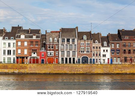 Maastricht Netherlands - April 11 2016:cityscape of Maastricht along the river Meuse with unidentified people. Maastricht is a university city and the capital of the Dutch province Limburg