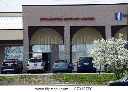 NAPERVILLE, ILLINOIS / UNITED STATES - APRIL 18, 2015: Immigrants may obtain assistant at the U.S. Citizenship and Immigration Service (USCIS) Application Support Center (ASC) in a Naperville strip mall.