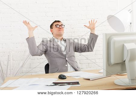 Winner businessman emotional, in white modern office interior, sitting at computer table. Office worker in eye glasses, job in internet. High key, soft tone. Businessman win prize, gambling.