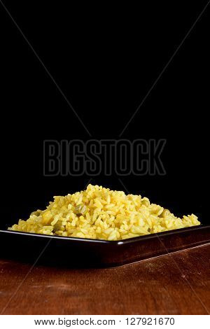 Delicious vegetarian risotto with saffron on wooden table