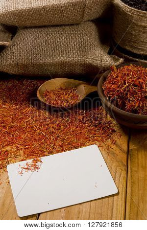 Spice saffron and bags on the wooden table