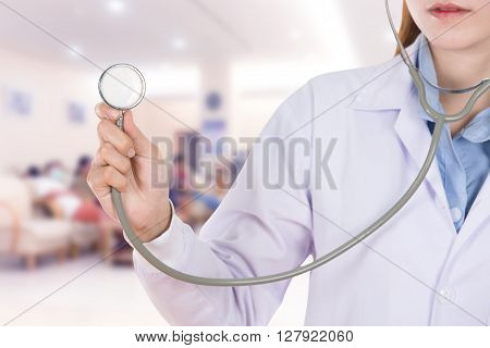 Close Up Stethoscope With Female Doctor In Hospital