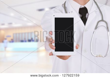 Doctor Showing Tablet Computer Blank Screen In Hospital