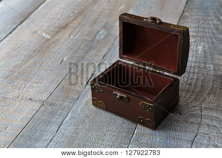 Wooden chest or trunk vintage style. Open Wooden chest box at serenity colored wooden plank table background. With copyspace.