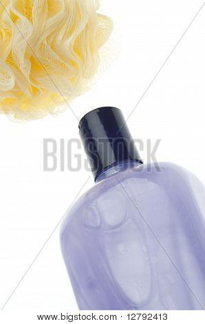 Spa Bath Concept With Sponge Poof And Purple Bubble Bath