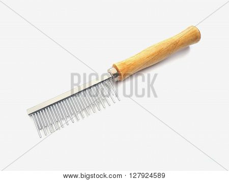 Wooden comb with metal prongs for grooming pet on white background