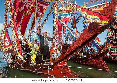 Semporna Sabah Malaysia - Apr 22 2016 : Traditional Bajau's boat called Lepa Lepa decorated with colorfull Sambulayang sail parading during annual Regatta Lepa Festival in Semporna Sabah.