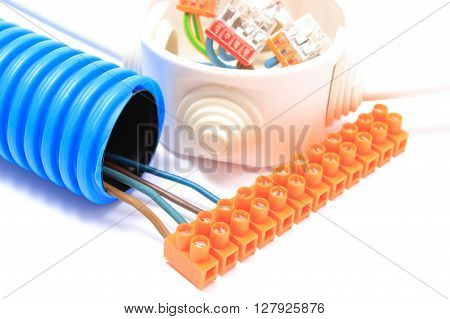 Corrugated plastic pipe copper wire connections in electrical box and components for use in electrical installations accessories for engineering jobs energy concept