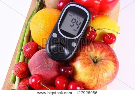 Glucose meter with fresh ripe fruits and vegetables concept of diabetes healthy food nutrition and strengthening immunity. White background