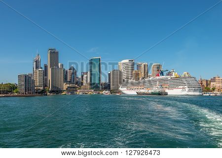 Sydney Australia - November 9 2014: Carnival Spirit Cruise Ship docked at the Circular Quay cruise terminal of Sydney Australia. The Circular Quay area is a popular neighbourhood for tourism and is made up of walkways pedestrian malls parks and restaurant