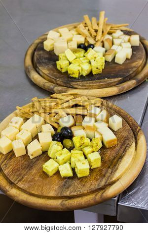 Cheese Board With Olives. Different Types Of Cheese