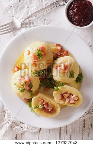 Potato Dumplings Stuffed With Ham, Bacon And Onion Close-up. Vertical Top View