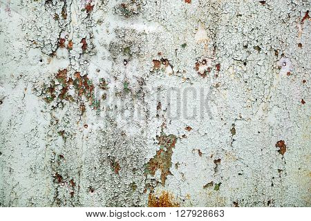 Background of old peeling paint with cracks and rust. Old weathered peeling paint texture.