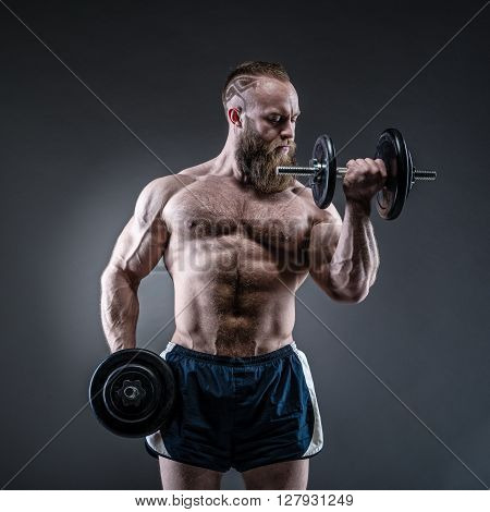 Strong Bodybuilder With Six Pack, Perfect Abs, Shoulders, Biceps, Triceps And Ches
