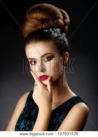 Fashion model touches face. Updo. Woman with healthy hair girl with luxurious haircut. Hair loss Woman with hair volume.