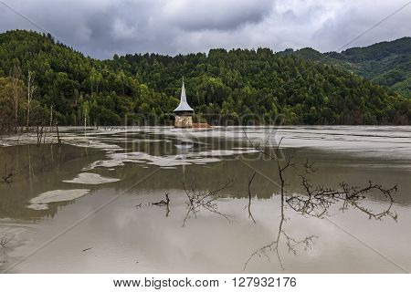 Church of polluted lake by mining in Romania