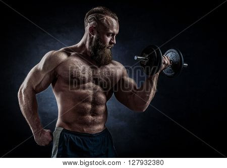 Power Athletic Bearded Man In Training Pumping Up Muscles With Dumbbell.