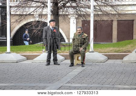 MOSCOW RUSSIA - April 24.2016: Artists depict the leaders of the Soviet Union Vladimir Lenin and Joseph Stalin on the Manezhnaya Square in city Moscow