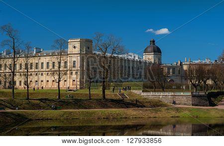 Gatchina, Russia - May 1, 2016: Gatchina Palace. View from the Karpin pond. View from the Karpin pond. Strict and grand palace.