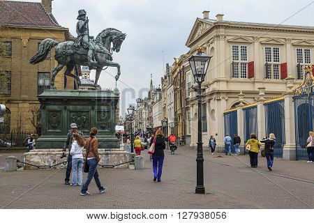 Hague, Netherlands - May 8: This is view of the street Noordeinde which runs past the Royal Palace Noordeinde and monument to King William I of Orange May 8, 2013 in Hague, Netherlands.