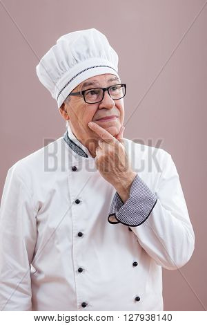 Portrait of restaurant's chef in working uniform thinking about meals