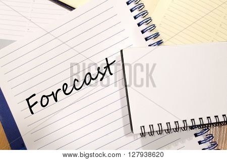 Forecast text concept write on notebook .