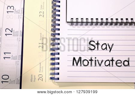 Stay motivated text concept write on notebook