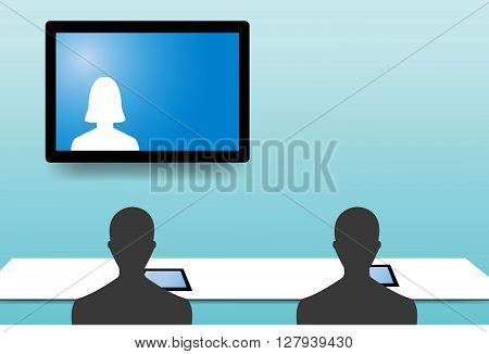 Silhouette figures of two men from behind are looking at a woman communicating with them from a monitor hanging on the green wall.Every man has a tablet on the table before him